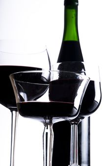 Three Glasses With Red Wine And Bottle Stock Photography