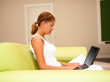 Free Young Woman Working On A Laptop Royalty Free Stock Images - 10025709