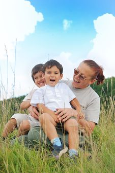 Happy Three Children In Nature With Grandmother Royalty Free Stock Photo
