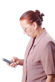 Middle Aged Woman Is To Talk On Phone Stock Images