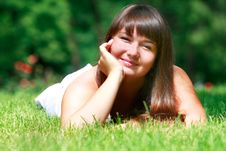Free Girl Laying In Green Grass Stock Images - 10027344