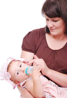 Free Mom Is Feeding Her Baby Royalty Free Stock Photography - 10027687