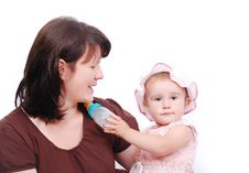 Free Mom Is Feeding  Baby And Vice Versa Royalty Free Stock Photos - 10027808
