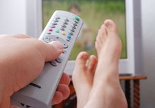 Remote Control In Hand Headed Into Television Royalty Free Stock Image