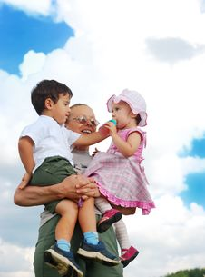 Grandmother And Kids In Her Armful Stock Photo