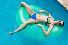 Free Woman In Inflatable Ring In Pool Royalty Free Stock Image - 10029636