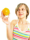 Free Happy Cute Young Lady With A Fresh Orange Stock Image - 10035081