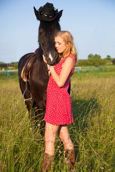 Young Blond Woman With Horse Stock Image