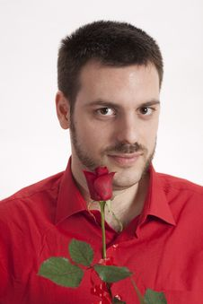 Free Handsome Man In A Red Shirt With Red Rose Royalty Free Stock Photography - 10033527