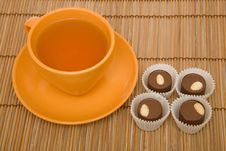 Free Cup Of Tea And Four Chocolate Sweets Stock Photos - 10033833