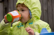 Little Girl Drinking Stock Photography