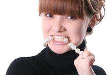 Free Girl Bites A Necklace Royalty Free Stock Images - 10034169