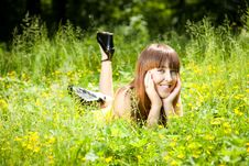 Free Pretty Smiling Girl Relaxing Outdoor Stock Images - 10034284