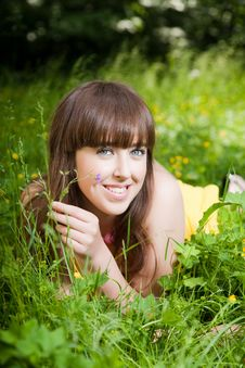 Free Beauty Young Woman Relaxing In The Grass Royalty Free Stock Image - 10034376