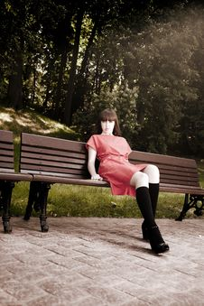 Beauty Woman Sitting On A Park Bench Royalty Free Stock Photo