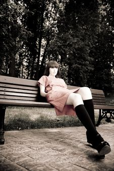 Free Pretty Woman Sitting On A Bench Royalty Free Stock Photography - 10034587