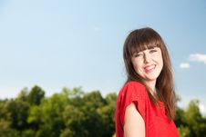Free Smiling Woman Against Blue Sky Stock Photography - 10034602