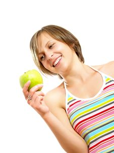 Free Smiling Cute Girl Holding A Green Apple Royalty Free Stock Photos - 10035058