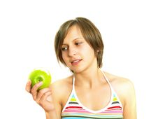 Pretty Young Lady With A Bitten Fresh Green Apple Stock Photo