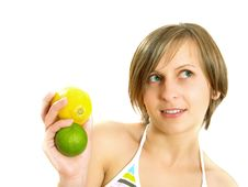 Free Cute Girl Holding Lemon And Lime Stock Photos - 10035093