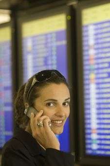 Free Airport Woman With Cellphone Stock Photography - 10036792