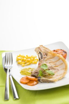 Free Tasty Pork Chop With Corn Carrot Tomato Royalty Free Stock Image - 10040146