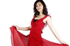 Chinese Girl In Red Skirt Royalty Free Stock Images