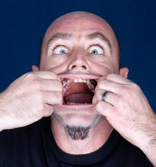 Free Man With Hands In Mauth Making Scared Expression Royalty Free Stock Photo - 10040885