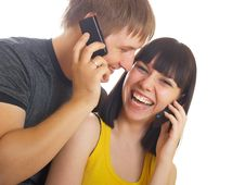 Free Couple On The Phone Together Royalty Free Stock Photography - 10040957