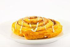 Cinnamon Bun On A White Plate Stock Image