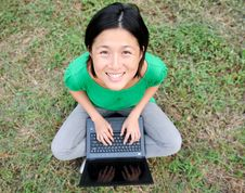 Free Asian Girl Smiling With Laptop Stock Photo - 10048700