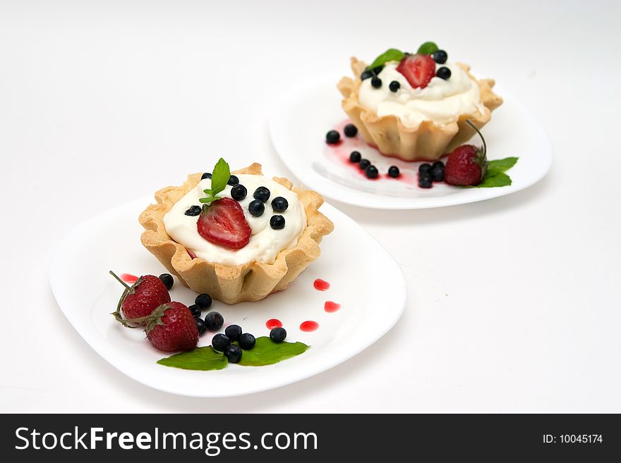 Delicious tarts with berries and cream