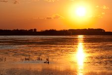 Prairie Sunset Reflecting In Water Stock Photography