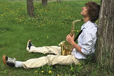 Young Man With Saxophone Stock Photography