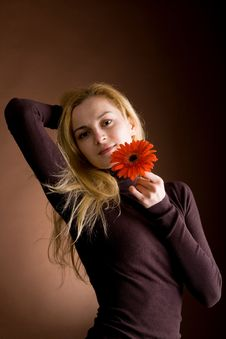 Free Young Blonde With A Red Flower Royalty Free Stock Image - 10054536