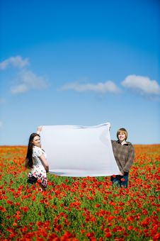 Free Lovely Couple In The Poppy Field Stock Photos - 10059363