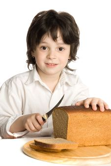 Free The Liitle Boy Wich Slicing A Bread On Desk Royalty Free Stock Photo - 10059605