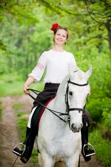 Free Smiling Girl Riding White Horse Royalty Free Stock Photos - 10059738