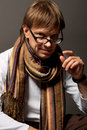 Free Man With Scarf Touching Glasses Royalty Free Stock Images - 10067299