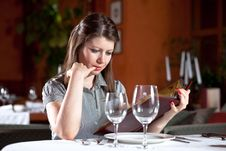 Free Girl Chooses Meal In Restaurant Stock Photo - 10060270