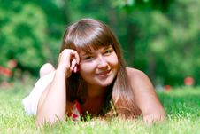 Free Girl Laying In Green Grass Royalty Free Stock Image - 10062256