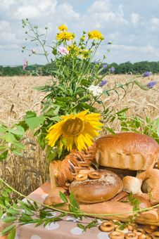 Free Wild Flowers And Bread. Royalty Free Stock Photography - 10065617