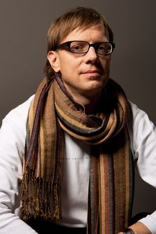 Man In Glasses And Scarf Smiling Stock Photo