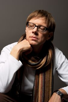 Man Thinking In Glasses With Scarf Stock Images