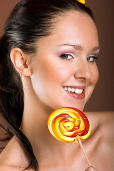 Free Smiling Woman With A Lollipop Stock Photo - 10069360