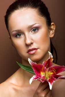 Free Beautiful Woman With A Flower Royalty Free Stock Photography - 10069367