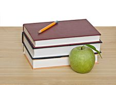 Apple And Pencil On Top Of Books Stock Photos