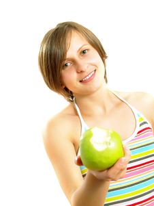Cute Girl Smiling, Giving A Green Apple Stock Photo