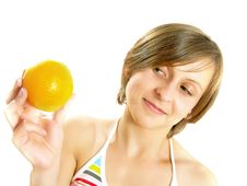Free Smiling Girl With A Fresh Orange Stock Photos - 10074043