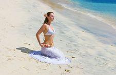 Brunette Girl Sitting On Sand Beach Stock Image